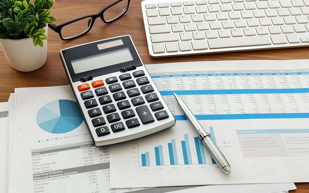 Desk of accountant performing accrual basis accounting
