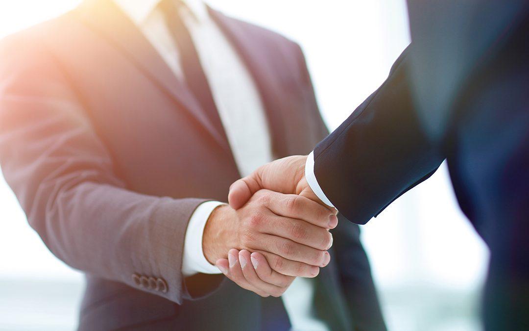 Financiers shaking hands after debt equity financing deal